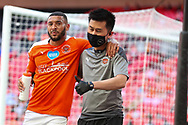 Blackpool Forward Keshi Anderson (8) goes off injured during the EFL Sky Bet League 1 Play-Off Final match between Blackpool and Lincoln City at Wembley Stadium, London, England on 30 May 2021.
