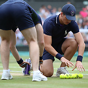 LONDON, ENGLAND - JULY 15: Ball boys in action during the Men's Doubles Final on Center Court during the Wimbledon Lawn Tennis Championships at the All England Lawn Tennis and Croquet Club at Wimbledon on July 15, 2017 in London, England. (Photo by Tim Clayton/Corbis via Getty Images)