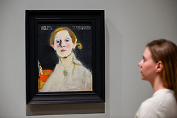 "© Licensed to London News Pictures. 17/07/2019. LONDON, UK. A staff member views ""Self-portrait, Black Background"", 1915, by Helene Schjerfbeck at the preview of the first solo UK exhibition of Finnish artist Helene Schjerfbeck at the Royal Academy of Arts in Piccadilly.  The exhibition features around 65 portraits, landscapes and still lifes and runs 20 July to 27 October 2019.  Photo credit: Stephen Chung/LNP"