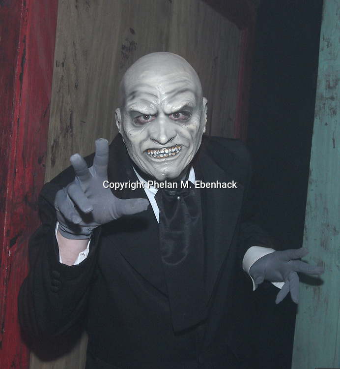A ghoul jumps out from a hiding spot in the Body Collectors: Collections of the Past venue during a dress rehearsal of Universal Studios Florida's Halloween Horror Nights in Orlando, Fla., Tuesday, Sept. 16, 2008.