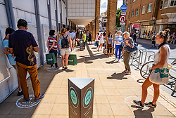 © Licensed to London News Pictures. 15/06/2020. London, UK. Shoppers queue at John Lewis in Kingston, South West London as non essential shops are given the green light to open in England after 3 months of being closed due to the coronavirus pandemic. Also commuters are told to wear face masks from Monday while travelling on Public transport. Photo credit: Alex Lentati/LNP