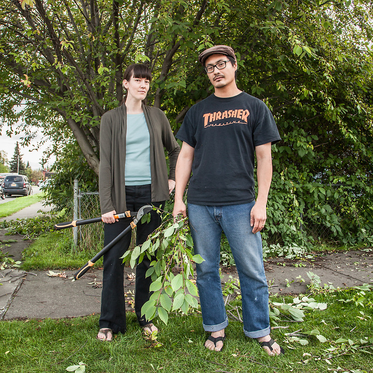 """""""These trees are long over due for a trim.""""  -Kim and Ted Kim trim their May Tree in Anchorage's South Addition neighborhood."""