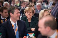 09 DEC 2014, KOELN/GERMANY:<br /> Angela Merkel, CDU, Bundeskanzlerin, sitzt waehrend dem Wahlgang fuer die Wahl der Bundesvorsitzenden zwischen den Delegierten aus Mecklenburg-Vorpommern, CDU Bundesparteitag, Messe Koeln<br /> IMAGE: 20141209-01-072<br /> KEYWORDS: Party Congress