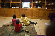 Children watching TV at Lambano Sanctuary, a hospice and care home for children who suffer from HIV. Guateng, South Africa.