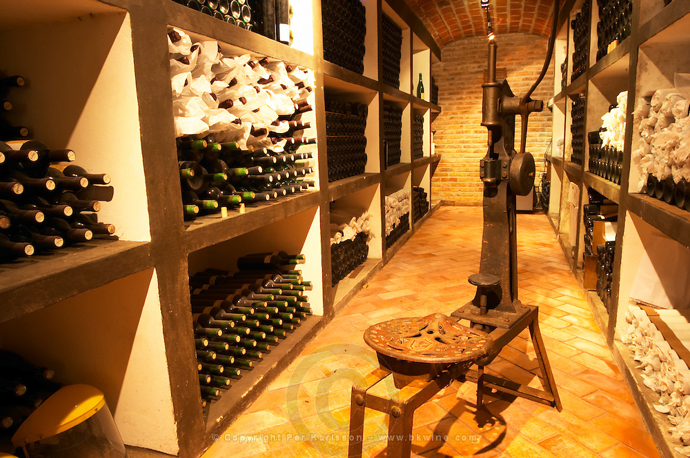 The bottle aging cellar with the private collection of wines and an old machine for bottling. Bodega Pisano Winery, Progreso, Uruguay, South America