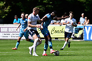 Jamille Matt (14) of Forest Green Rovers battles for possession during the Pre-Season Friendly match between Yate Town and Forest Green Rovers at the Jelf Stadium, Yate, United Kingdom on 17 July 2021.