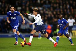 Tottenham Hotspur's Dele Alli and Leicester City's Vicente Iborra battle for the ball during the Premier League match at the King Power Stadium, Leicester.