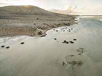 Aerial view of transparent water of Sotavento lagoon in Fuerteventura, Canary islands.