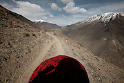 Point of view of the photographer. Trekking up and along the Wakhan river, the only way to reach the high altitude Little Pamir plateau, home of the Afghan Kyrgyz community.