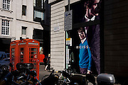 Large fashion posters belonging to the Reiss store on the corner of Sackville and Vigo Street.