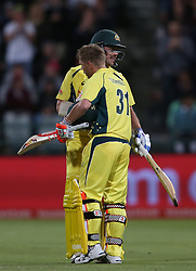 Travis Head of Australia congratulates David Warner of Australia for reaching his century during the 5th ODI match between South Africa and Australia held at Newlands Stadium in Cape Town, South Africa on the 12th October  2016<br /> <br /> Photo by: Shaun Roy/ RealTime Images