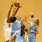 New Hanover's Alex Simmons grabs a loose ball from Hoggard's Aleah Thompson, left, Tara Poteat, center, and Emma Haywood. (Jason A. Frizzelle)
