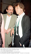 Mick Jagger and Salman Rushdie. Royal Court Theatre 40th Anniversary Gala. Porchester Hall. 31/10/96. Film 96709f37<br />© Copyright Photograph by Dafydd Jones<br />66 Stockwell Park Rd. London SW9 0DA<br />Tel 0171 733 0108
