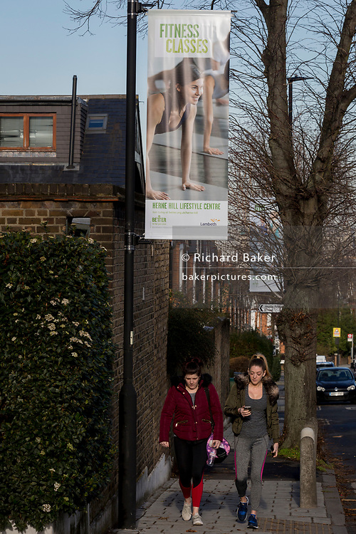 GLL (Greenwich Leisure Limited) banners opposite Carnegie Library on Herne Hill SE24, on 10th February 2019, in London, England.