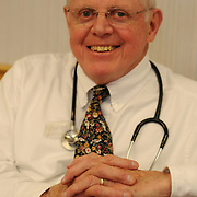 """Dr. Peter McGuire, founder of Oasis Health Network, a free health care network in Brunswick says, """"It's not that we are trying to do a better job than other practitioners, it's that we can -- because we don't have the overhead."""" Using lent space, volunteer staff and donated medications, Oasis doctors and staff see about 800 different people each year - in 2,800 visits. The organization, founded, by McGuire in 1995, is supported by many other local organizations and provides a broad spectrum of healthcare services, all donated.   Photo by Roger S. Duncan."""