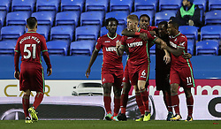 Swansea's Alfie Mawson (centre right) celebrates scoring his side's first goal of the game during the Carabao Cup, third round match at the Madejski Stadium, Reading.