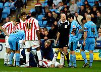 Photo: Ed Godden.<br />Coventry City v Stoke City. Coca Cola Championship. 02/12/2006. Stoke's Danny Higginbotham lies injured on the floor.