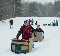 "The sticky snow made a good match with Liam Culver's ""Creeping Creeper"" as he's followed by his brother Aidan Culver on ""The Ripper"" during Gilford Parks and Recreation's annual Cardboard Derby race at the Outing Club.  (Karen Bobotas/for the Laconia Daily Sun)"