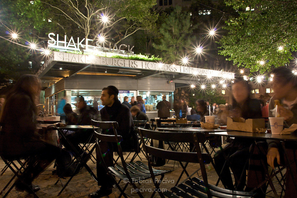 Crowds dine at popular hamburger and milkshake stall Shake Shack in Madison Square, Manhattan, New York.