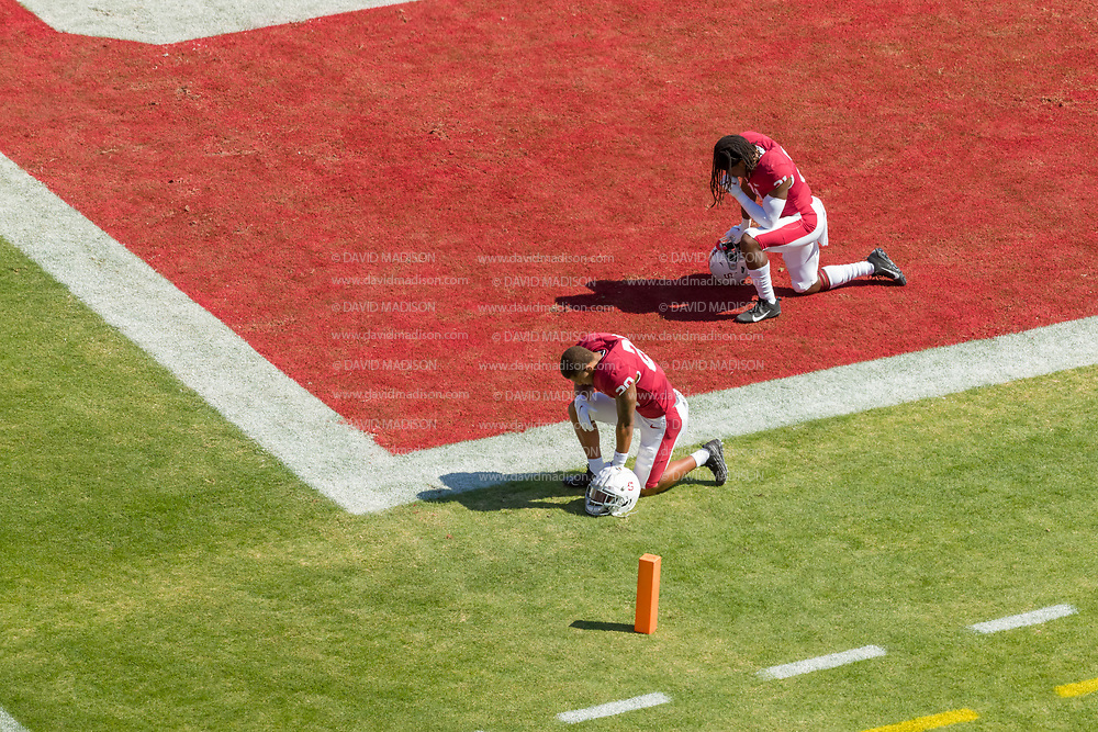 PALO ALTO, CA - OCTOBER 2:  Austin Jones #20 and Kendall Williamson #21 of the Stanford Cardinal kneel on the field prior to  a Pac-12 football game against the Oregon Ducks on October 2, 2021 at Stanford Stadium in Palo Alto, California.  (Photo by David Madison/Getty Images)