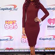 NATALIE LA ROSE walks the red carpet at the Hot 99.5 Jingle Ball at the Verizon Center in Washington, D.C.
