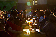 People enjoying a few drinks during the Euro 2020 semi final match between England and Denmark on the 7th of July 2021 at the outdoor screen at Folkestone Harbour Arm, in Folkestone, United Kingdom.