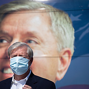 NORTH CHARLESTON, SC - OCT 16: South Carolina Senator Lindsey Graham arrives to address supporters at a get out the vote rally at the Charleston Coliseum and Convention Center in North Charleston, South Carolina on October 16, 2020. Senator Graham is campaigning as his Democratic opponent Jaime Harrison's campaign has been out-raising the incumbent.  (Photo by Logan Cyrus for AFP)