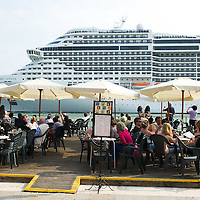 VENICE, ITALY - JUNE 02:  MSC Divina sails in front of Gelateria Nico just after few hours stop on June 2, 2012 in Venice, Italy. At 139, 000 tons, the MSC Divina can carry nearly 4,000 passengers. FAI (Fonto Ambientale Italiano) is now supporting Venetians and environmentalists in their protetst against cruise ships sailing in St Mark's basin, arguing that the increased boat traffic on Venice's waterways increases pollution and damages property.  (Photo by Marco Secchi/Getty Images)