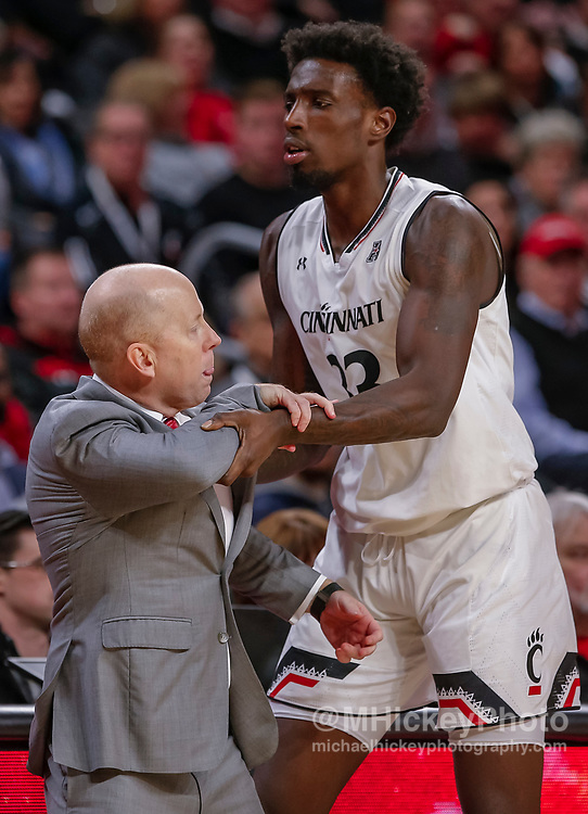 CINCINNATI, OH - JANUARY 15: Head coach Mick Cronin is restrained by Nysier Brooks #33 of the Cincinnati Bearcats after a technical foul and ultimate ejection during the second half of the game against the South Florida Bulls at Fifth Third Arena on January 15, 2019 in Cincinnati, Ohio. (Photo by Michael Hickey/Getty Images) *** Local Caption *** Mick Cronin; Nysier Brooks