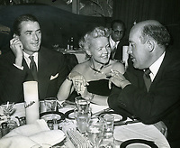 1952 Gregory Peck and wife, Greta, chat with actor Fred Clark at Ciro's Nightclub