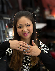 Tammy Cao, a licensed beautician in Alameda, Calif., shows off her own manicure while at work at Tulip Nails on Wednesday, April 26, 2017. (Photo by D. Ross Cameron)