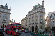 With a further 149 reported dying from Coronavirus in the last 24hrs, taking the UK death toll to 43,320, the junction of Piccadilly Circus and Regent Street where green pedestrian social distance barriers widen the pavement during the Covid pandemic, on 25th June 2020, in London, England.