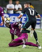 Manchester City defender Eliaquim Mangala , left, and Real Madrid forward Lucas Vazquez fighter for the ball during the second half of the International Champions Cup match on July 26, 2017 in Los Angeles, California. Manchester City won 4-1.  AFP PHOTO / Ringo Chiu