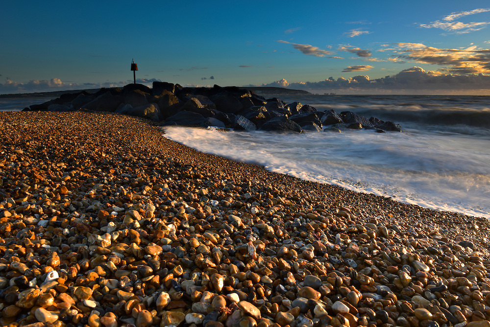 Waves hitting the beach on Hurst Spit, Milford-on-Sea, Hampshire at sunset
