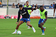 AFC Wimbledon defender Deji Oshilaja (4) and AFC Wimbledon defender Will Nightingale (5) warming up during the EFL Carabao Cup 2nd round match between AFC Wimbledon and West Ham United at the Cherry Red Records Stadium, Kingston, England on 28 August 2018.