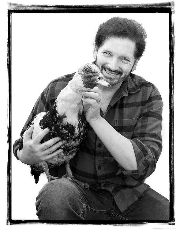 Founder Gary Mitchell & Fernando, a Muscovy duck (Cairina moschata). Planet Rehab Animal Sanctuary, San Dimas, California.