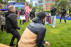 © Licensed to London News Pictures. 16/06/2019. Manchester, UK. Fans play their own impromptu game of cricket as rain stops play . Cricket fans watch India play Pakistan on a live screen in Cathedral Gardens , as the the two sides meet in the ICC Cricket World Cup at Old Trafford . Photo credit: Joel Goodman/LNP