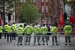 © Licensed to London News Pictures . 23/10/2015 . Manchester , UK . A large police presence in Albert Square outside Manchester Town Hall waiting for Chinese president , Xi Jinping , who is visiting Manchester as part of his state visit to the United Kingdom . Photo credit: Joel Goodman/LNP