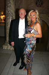 JOHN CAUDWELL founder of Phones4U and CLAIRE JOHNSON at the British Fashion Awards 2006 sponsored by Swarovski held at the V&A Museum, Cromwell Road, London SW7 on 2nd November 2006.<br /> <br /> NON EXCLUSIVE - WORLD RIGHTS