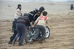 Shinya Kimura, Go Takamine and others help Shinsuke Takizawa of Neighborhood in Japan at TROG West - The Race of Gentlemen. Pismo Beach, CA, USA. Saturday October 15, 2016. Photography ©2016 Michael Lichter.