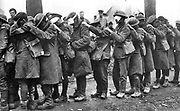 World War I 1914-1918: The blind leading the blind. Men of the 55th British Division, casualties of a  poison gas attack walking in single file with hand on shoulder of man in front, 10 April 1918. Chemical Warfare Military Soldier
