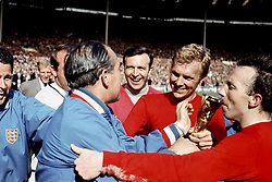 File photo dated 30-07-1966 of Sir Alf Ramsey, Bobby Moore and Nobby Stiles with the World Cup 1966 trophy. Issue date: Tuesday June 1, 2021.