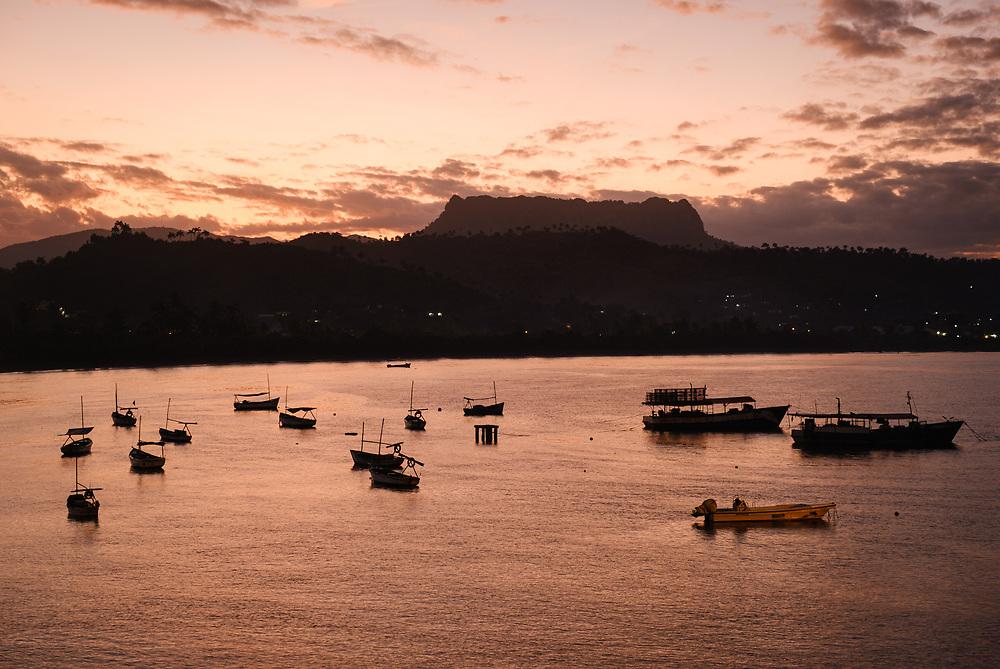 BARACOA, CUBA - CIRCA JANUARY 2020: Bay of Baracoa and boats during sunset.