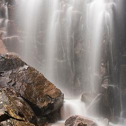 A waterfall along Hadlock Brook as seen from Waterfall Bridge in Maine's Acadia National Park.