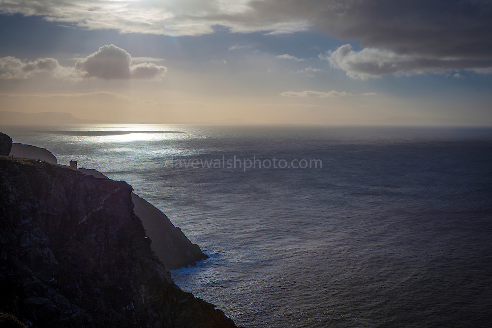 """The Atlantic Ocean, Donegal Bay and and in the background, the mountain of Ben Bulben. View from Bunglass, at the Slieve League cliffs on the Atlantic coast of Donegal, Ireland, on the Wild Atlantic Way. At 601m, these cliffs are three times higher than the more famous Cliffs of Moher. The mountain has had a sacred status before, and during early Christian times, with traces of monastic huts in the area and numerous megalithic structures. This mage can be licensed via Millennium Images. Contact me for more details, or email mail@milim.com For prints, contact me, or click """"add to cart"""" to some standard print options."""