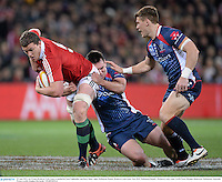 25 June 2013; Ian Evans, British & Irish Lions, is tackled by Scott Fuglistaller and Rory Sidey, right, Melbourne Rebels. British & Irish Lions Tour 2013, Melbourne Rebels v British & Irish Lions. AAMI Park, Olympic Boulevard, Melbourne, Australia. Picture credit: Stephen McCarthy / SPORTSFILE