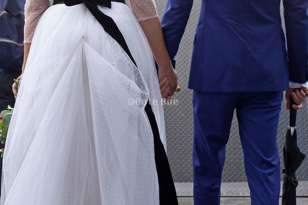 bride and groom in casual way on their way to the wedding party