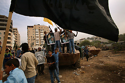 Palestinians demonstrate by jumping on damaged Palestinian tanks after the news of Yasser Arafat's death spread, Gaza, Palestinian Territories, Nov. 11, 2004. Arafat died in a Paris hospital at the age of 75.
