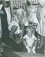 """1960 Jayne Mansfield's Walk of Fame ceremony, pictured with her son Mickey """"Miklos"""" Hargarity Jr. and her mother Vera Jeffrey Palmer Peers"""
