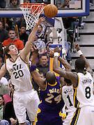 Utah Jazz guard Gordon Hayward (20) blocks a shot from Los Angeles Lakers guard Kobe Bryant (24) as Utah Jazz point guard Earl Watson (11) and forward Josh Howard (8) also defend during the second half of an NBA basketball game, Saturday, Feb. 4, 2012, in Salt Lake City. The Jazz beat the Lakers 96-87. (AP Photo/Colin E Braley).